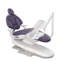 A-dec dental chair with plum upholstery and dental delivery system