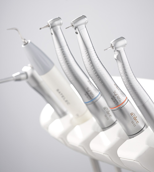 Dental handpieces and integrated instruments
