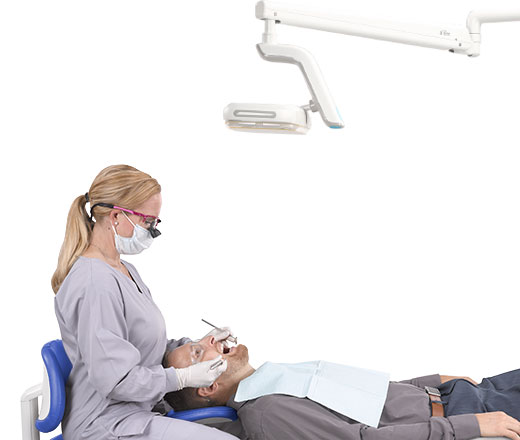 A-dec 500 LED dental light during dental procedure